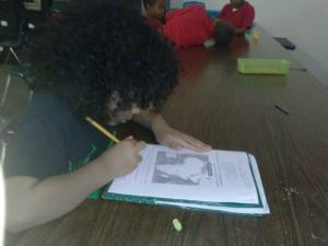 Jayla busy with homework!